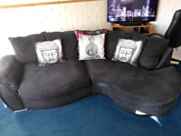 (BARGAIN) CORNER SOFA IN GOOD CONDITION STURDY COMES IN 2 PARTS ,BLACK WITH CUSHIONS READ FULL AD