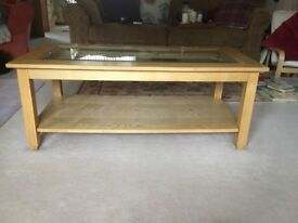 Glass top oak coffee table