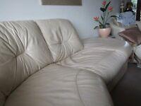 cream leather corner sofa, 4yrs old reasonable condition.