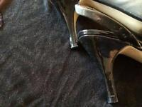 Shiny grey n black high heels shoes with a back strap