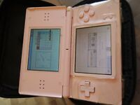 Nintendo DS in pink with case,charger and games.