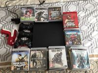 PS3 slim with 53 games, 3 controllers, a PS3 move camera and gun attatchment no ps move controller.