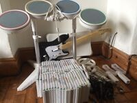 Wii games bundle and accessories ( incl rockband kit, microphones and balance board)
