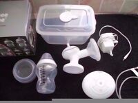 tommee tippee electric breast pump excellent condition, 2 new bottles, from pet and smoke free home