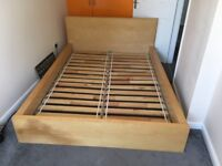 A double bed by Ikea Malm model