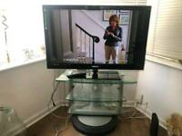 "42"" TV with Rotating Glass Stand"