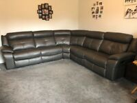 AS NEW leather corner sofa in dark grey with recliners