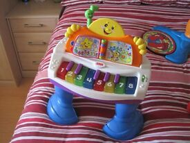 fisher price laugh and learn grand piano activity table