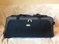 Large blackTravel bag with wheels and a retractable handle