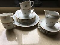 PRETTY CUPS SAUCERS AND PLATES
