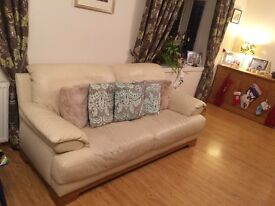 Large cream leather sofa