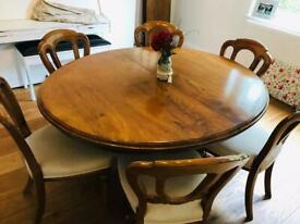 Restored antique dining table with 6 chairs