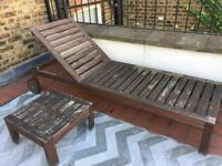 wooden sun lounger and table