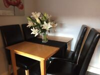 Table & 4 black chairs for sale