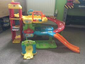 Vtech toot toot garage with small amount of track and 1 car