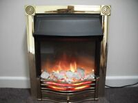 Impressive flame effect electric fire. Rarely used and immaculate.