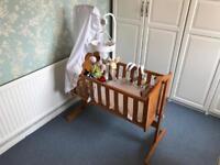 Rocking crib with Winnie the Pooh detail