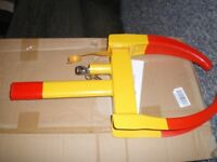 WHEEL CLAMP, NEW. NO MAKERS NAME