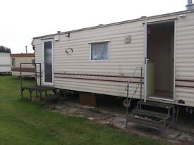 Static caravan for sale good con. Two bedrooms on friendly family park close to beach