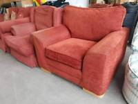 Large red fabric armchair