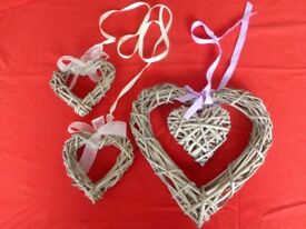 Three woven wicker love hearts
