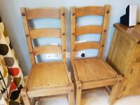 8 heavy, solid oak dining chairs.