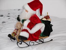 Santa Claus on small sleigh