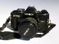 Minolta X-700 35mm SLR film camera with Minolta 50mm lens and Sigma 70-210mm zoom lens