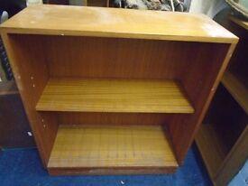 small light wood shelf unit.