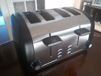 Cookworks 4 slice toaster. Defrost, reheat and cancel facility.