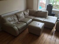 Cream leather corner sofa with footstool and arm chair