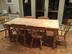 6Ft farmhouse table + 6 chairs includes 2 carvers. Great condition reluctant sale due to housemove