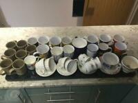 Section of mugs and cups and saucers