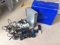 Silver PS 2 + Games + Memory Cards