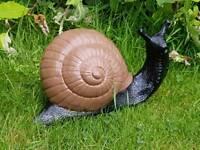 Snail ; cast stone , painted