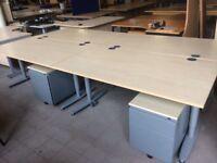 Set of 4 light oak desks with pedestals