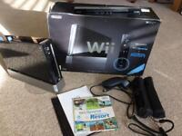 Black boxed Nintendo Wii console and accessories