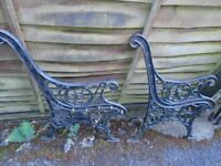Cast iron bench ends with lions faces.