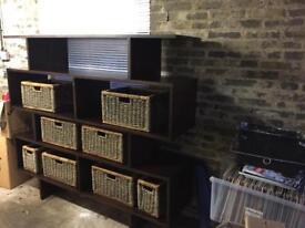 Dark wood shelf unit with basket storage