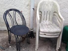 3 black metal chairs and 3 white plastic chairs