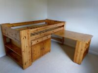 Mid-sleeper bed with cabinet and table