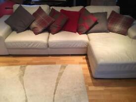 Cream corner sofa with chaise.