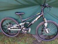 "Boys 24""wheel full suspension mountain bike."