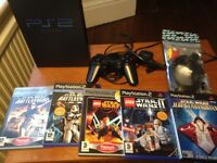 PS2 Console, control pad and 5 Starwars games.