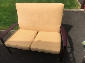 Two seater Parker Knoll in excellent condition . Never been seated on. 65 pounds ovno