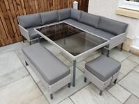 8 Seater Grey Rattan Style Patio Dining Set - 5-seater corner sofa, 2-seater bench, stool and table.