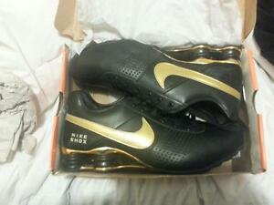 size 12 nike shox gold and black leather ne in box