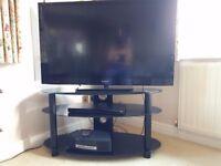 Black glass, three shelved TV stand