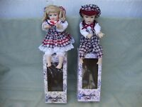 Brother and Sister Chiming Dolls, in original boxes,with key