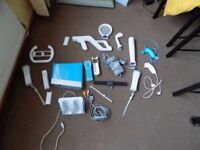 Blue Limited Edition Nintendo Wii Bundle including Games, Accessories and a charging dock.
